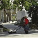 Mopping Revolution Plaza in Bayamo