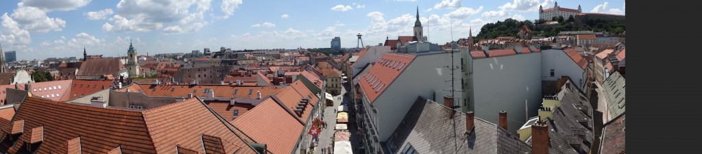 From St. Michael's Gate overlooking town hall tower, UFO, St. Martin's and Bratislava Castle.