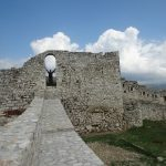 Walls of Berat Castle high over city of same name